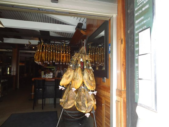 Hotel Balmes: Hams at the entrance of Cerveceria Costa Gallega