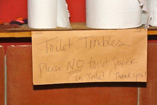 El Centro: Sign in toilet