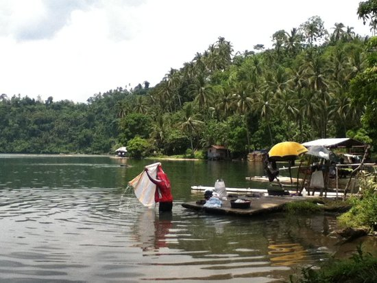 Sampaloc Lake: local woman washing clothes