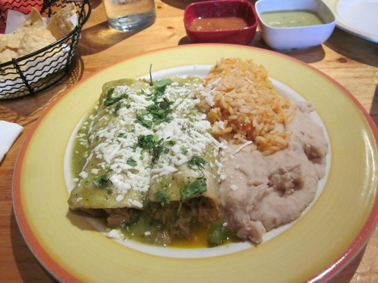 Maya: Chicken enchiladas with rice and beans.