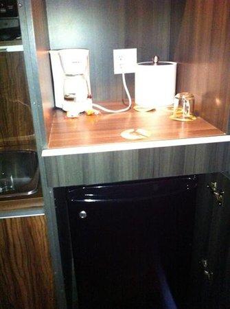Hotel Zero 1: mini fridge and coffee maker(also provide a wine opener and wine glasses)