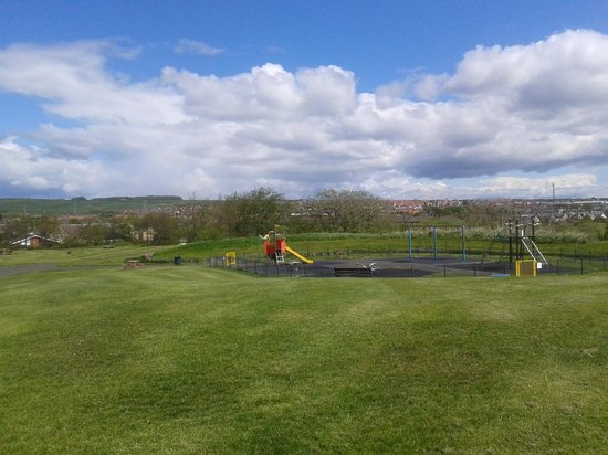 Playpark on Cannon hill with view of Ardrossan from Cannon Hill (Ardrossan Castle) in the backgr