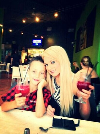 Sage Cafe Restaurant: my son and I at sage our fav place to go to. im having a daiquiri and hes having a childs friend
