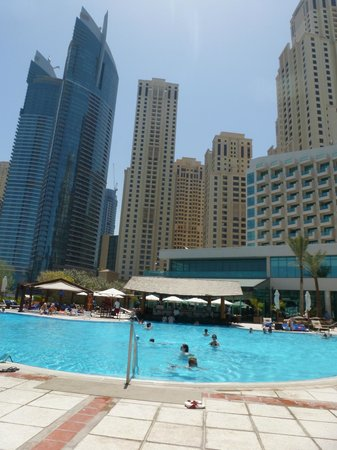 Hotel seen from the walk picture of hilton dubai - Jumeirah beach hotel swimming pool ...
