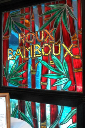 "Sundy House: ""Roux Bamboo"" stained glass in serving area. There are many varieties of bamboo growing in the g"