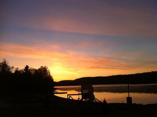 Oxtongue Lake Cottages: sun rising on Oxtongue Lake May/2013