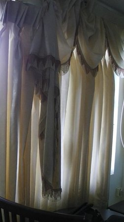 Estate Residency: Falling curtains in the room