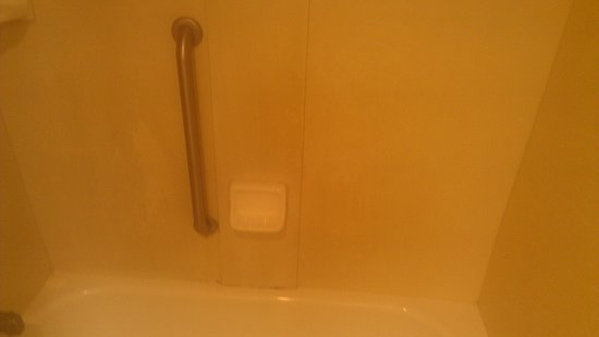 Comfort Inn & Suites Lantana - West Palm Beach South: loosse grab bar with yummy caullk and soap scum