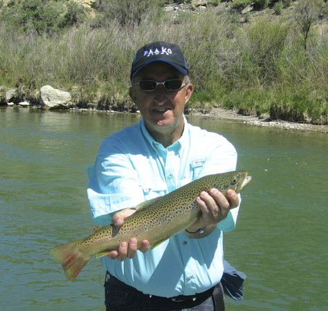 Soaring Eagle Lodge: My husband with his Brown Trout