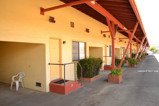 Colombi Motel: Exterior of the motor court, showing the carport that each room has..