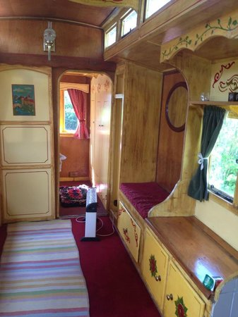Walcot Hall: The traditional painted insides of the showmans caravan.