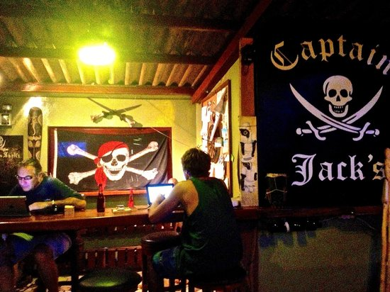 Captain Jack's Canopy Bar and Restaurant: A view of Captain Jack's at night, with the eponymous Captain seated on the left.