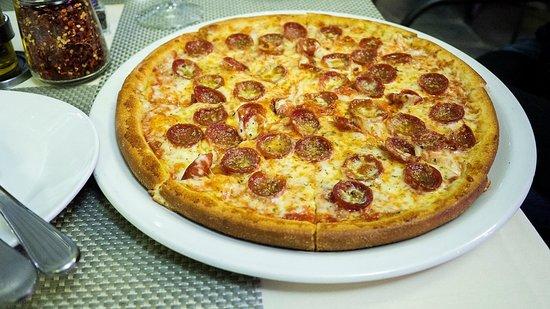 Ovenella's Molinari Pepperoni, an Italian pepper cured salami, mozzarella cheese and orégano pie