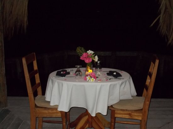 Thatch Caye, a Muy'Ono Resort: private romantic dinner over the water