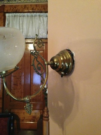 Baker House Bed and Breakfast: Detached and exposed wires.  Sconce #2