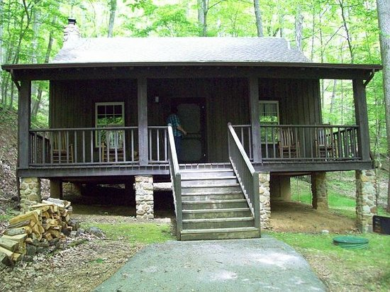 Roan Mountain State Park: One of the cabins.  They all have rocking chairs and stacked wood
