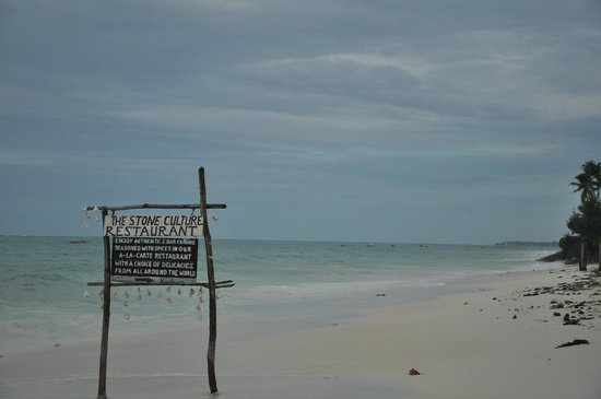 The Stone Culture Restaurant: The Stone Culture sign on the beach