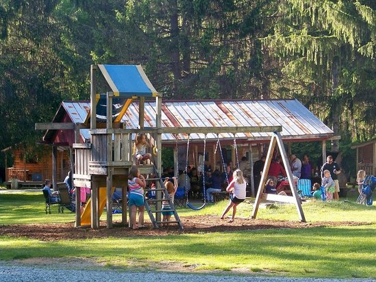 Flintlock Family Campground: Play ground area w/ pavillion in background