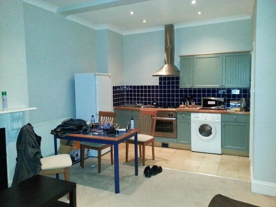 Brackenbury Serviced Apartments : Big living room/kitchen (not shown: 2 seater sofa, TV & sofa bed). We dumped our stuff everywher