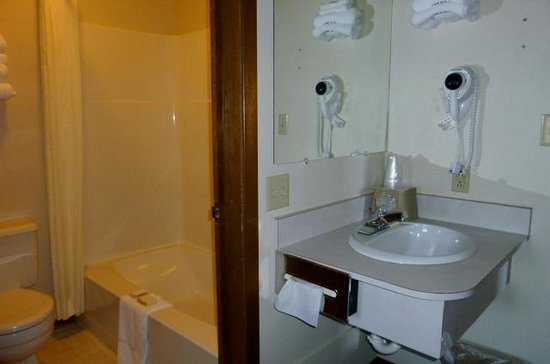 The Country Inn: Your private bathroom features a convenient separate vanity and sink area.