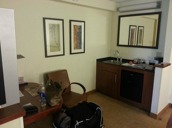 Hyatt Place Colorado Springs: From couch, see desk & sink & fridge area