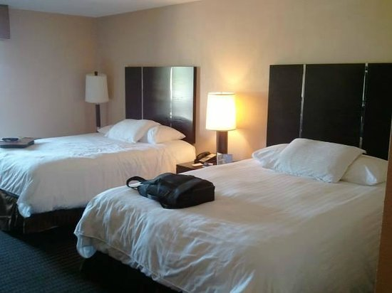 The Pacific Inn: Beds in 1st room of suite.