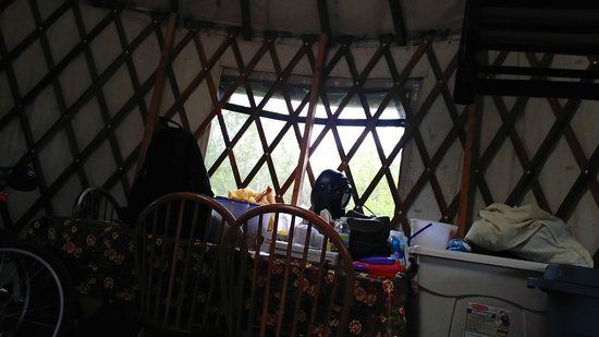 Maumee Bay State Park: Back side of Yurt has kitchen table with 4 chairs and a bench.