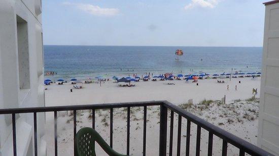 Island Sunrise: balcony view of beach
