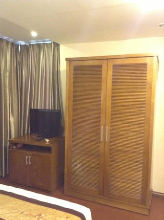 Tu Linh Palace Hotel 2: The TV and wardrobe