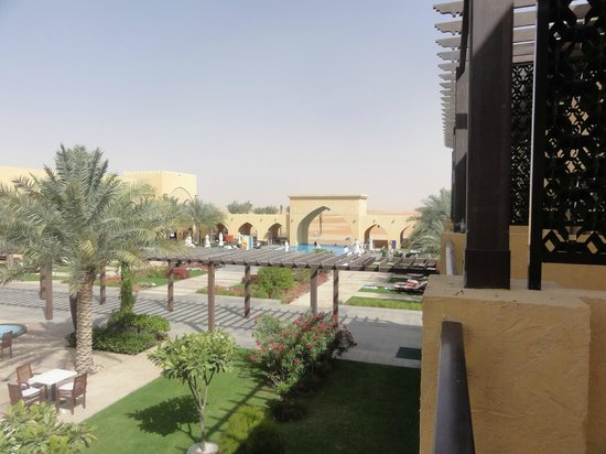 Tilal Liwa Hotel: The pool and surrounding grounds  in a courtyard setting.