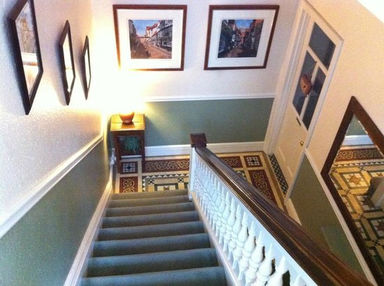Ashbourne House: View from stairs of beautiful flooring and paintings