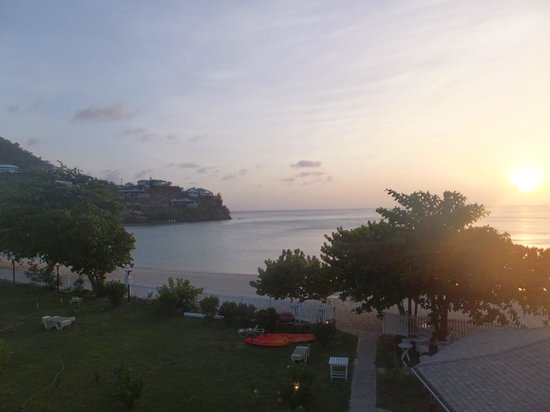 Kalinago Beach Resort : Sunset from room looking over Morne Rouge beach