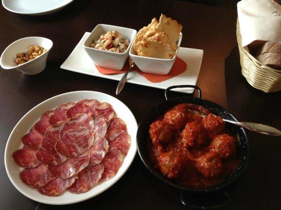 Mucho Gusto: Lomito, meatballs in spicy tomato sauce, and ceviche de cams tones casero.