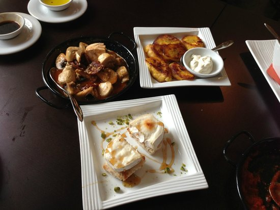 Mucho Gusto: Goat cheese with oak forest honey, mushrooms with chorizo, and pan-fried plantains.