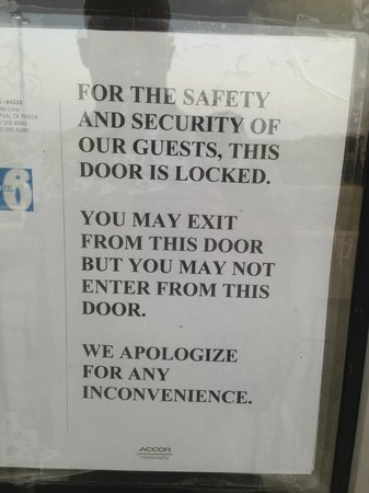 Motel 6 Marble Falls: Note on Door from Hotel. Since card reader not working door propped open and anyone can get in.