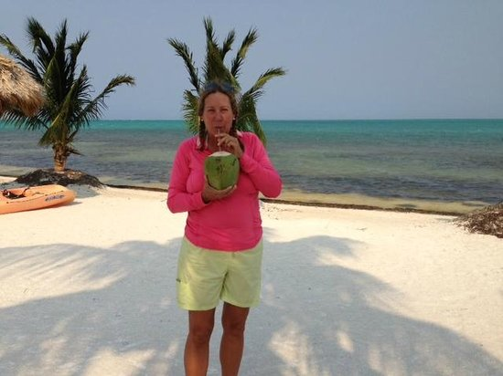 St. George's Caye Resort : A staff member brought me a fresh coconut.....Yummy!