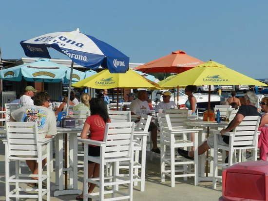 Dockers Restaurant: Patio on a busy day with entertainment.