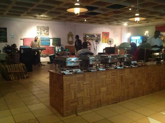 Spice Foods: The buffet table and the live band with some cozy rugs on the walls in the background