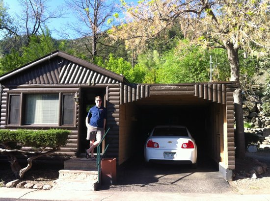 Silver Saddle Motel: My husband and our cabin, with carport for our rental