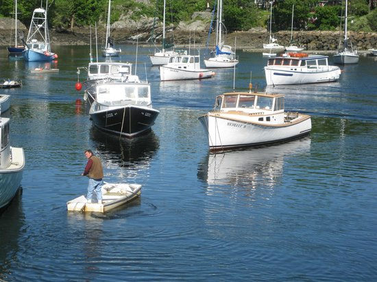 Four Mile Lobster: The lobsterman himself rowing out to his boat the Michelle D. in Perkins Cove