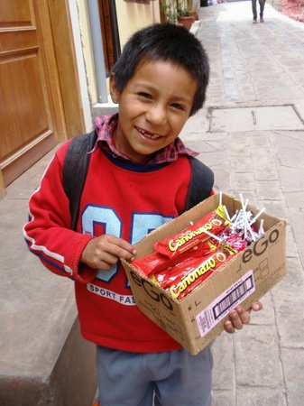 Los Aticos: Young boy selling chocolates outside hotel