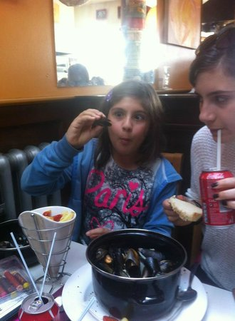 Belgian Cafe: my children tucking in