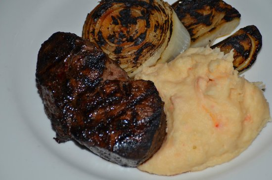 Embers Wood Grill : A  perfectly prepared Fillett Mignon, with seared Valdallia onions, and Lobster mashed potatoes.