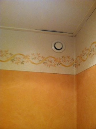 Hotel Monet: cracks and mold in the ceiling of bathroom.  room#4