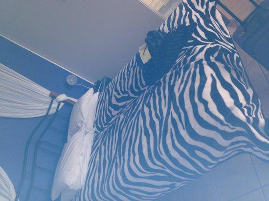Chateau Beachside: Fake wall behind bed with zebra blanket
