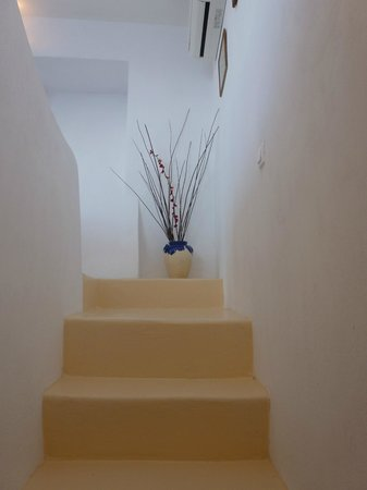 Stairs leading down to our blue tile bathroom