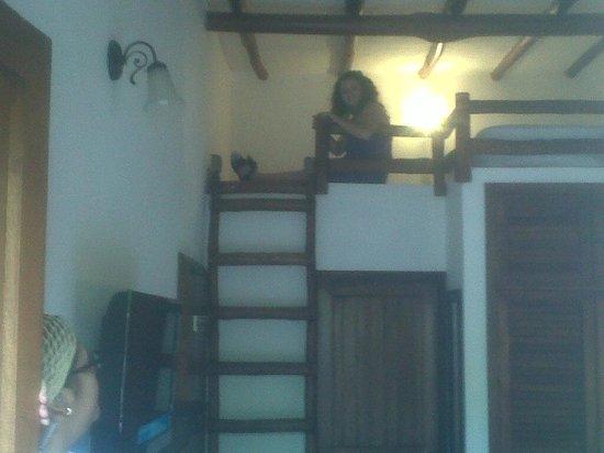 La Ardilena: cama en la habitacion triple