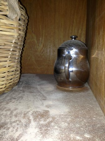 Calabash Luxury Boutique Hotel & Spa: Kitchen cupboard full of ant killer which covered equipment