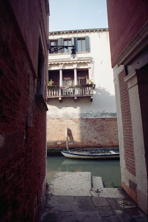 Locanda La Corte: View across canal to side of hotel