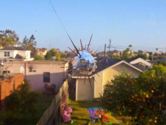 Americas Best Value Inn Oxnard / Port Hueneme: Bullet hole(?) in window